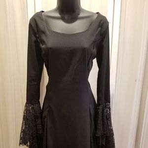 Fit and flare black dress with lace sleeves.